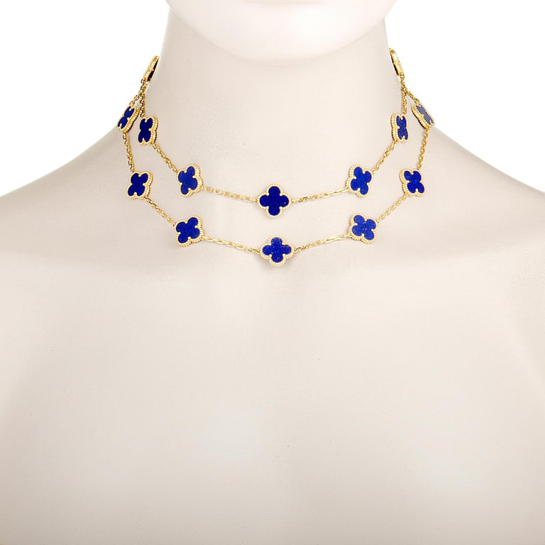 """Perfectly complementing the luxurious radiance of 18K yellow gold, the fascinating lapis lazuli gives an incredibly high-end appeal to this exquisite necklace that is presented by Van Cleef & Arpels within the iconic """"Alhambra"""" collection. Included"""