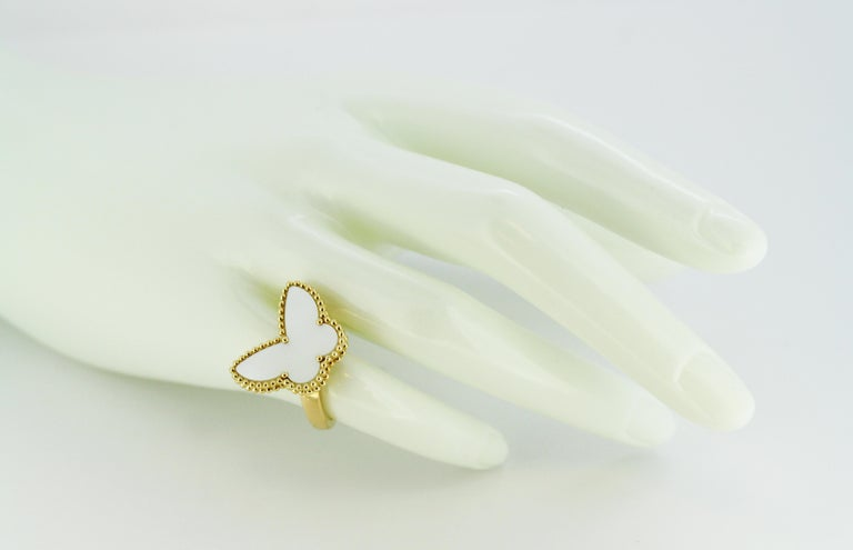 18kt yellow gold mother of pearl ring with butterfly shape by Van Cleef & Arpels.  Made in France, Paris Circa 2000's  Fully hallmarked.  Dimension -  Size : 2.4 x 2.3 x 1.7 cm Finger Size : (UK) = J (US) = 5 1/4 (EU) = 49 1/2 Weight : 10