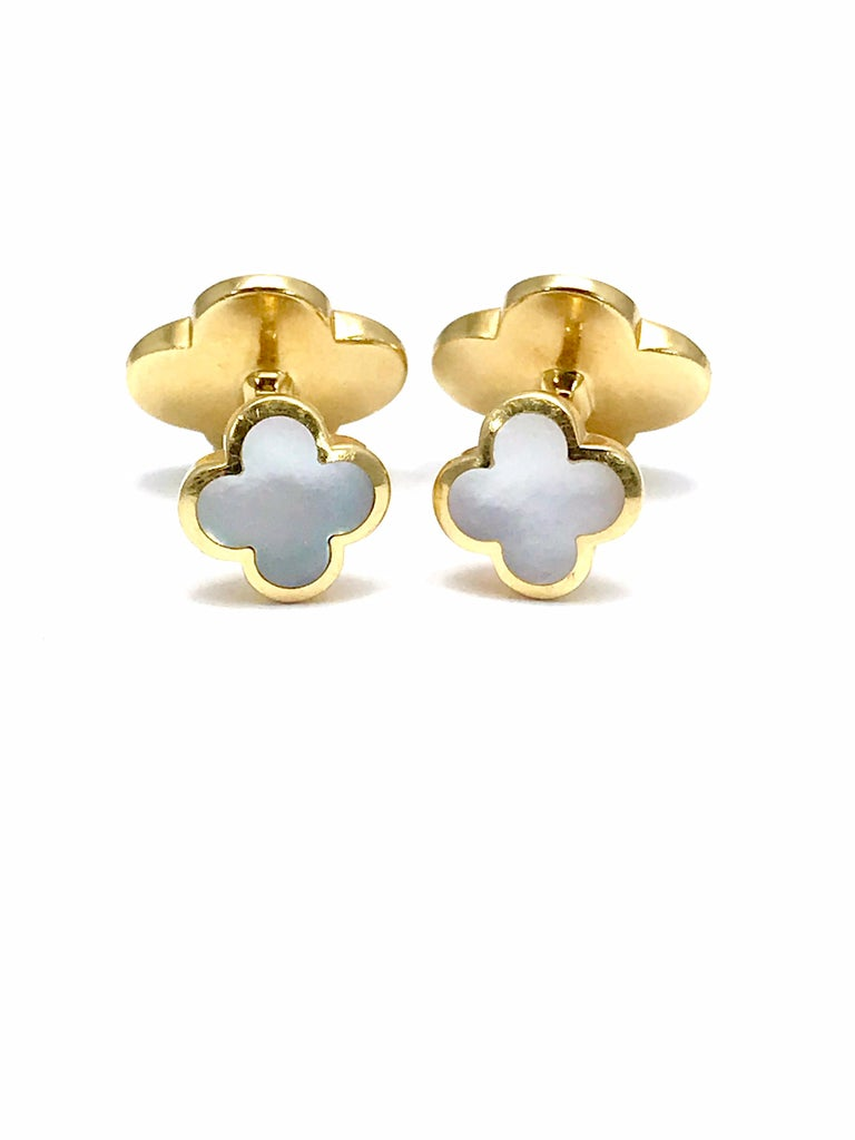 Boasting the appealing and instantly recognizable motif of the famed Alhambra collection, these elegant cufflinks from Van Cleef & Arpels are made of spotless 18K yellow gold and set with splendid mother of pearl to emphasize their neat form.  The