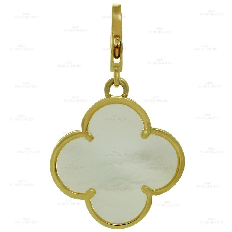 This iconic Van Cleef & Arpels Alhambra pendant features the festive lucky clover design crafted in 18k yellow gold and inlaid with mother-of-pearl. Made in France. Measurements: 0.86