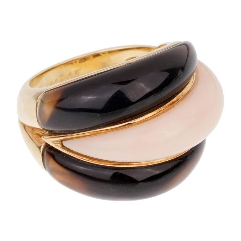 A magnificent Van Cleef & Arpels ring showcasing Angel Skin Coral and a very deep colored Smokey Quartz set in 18k yellow gold.  Size 5 (Resizeable)