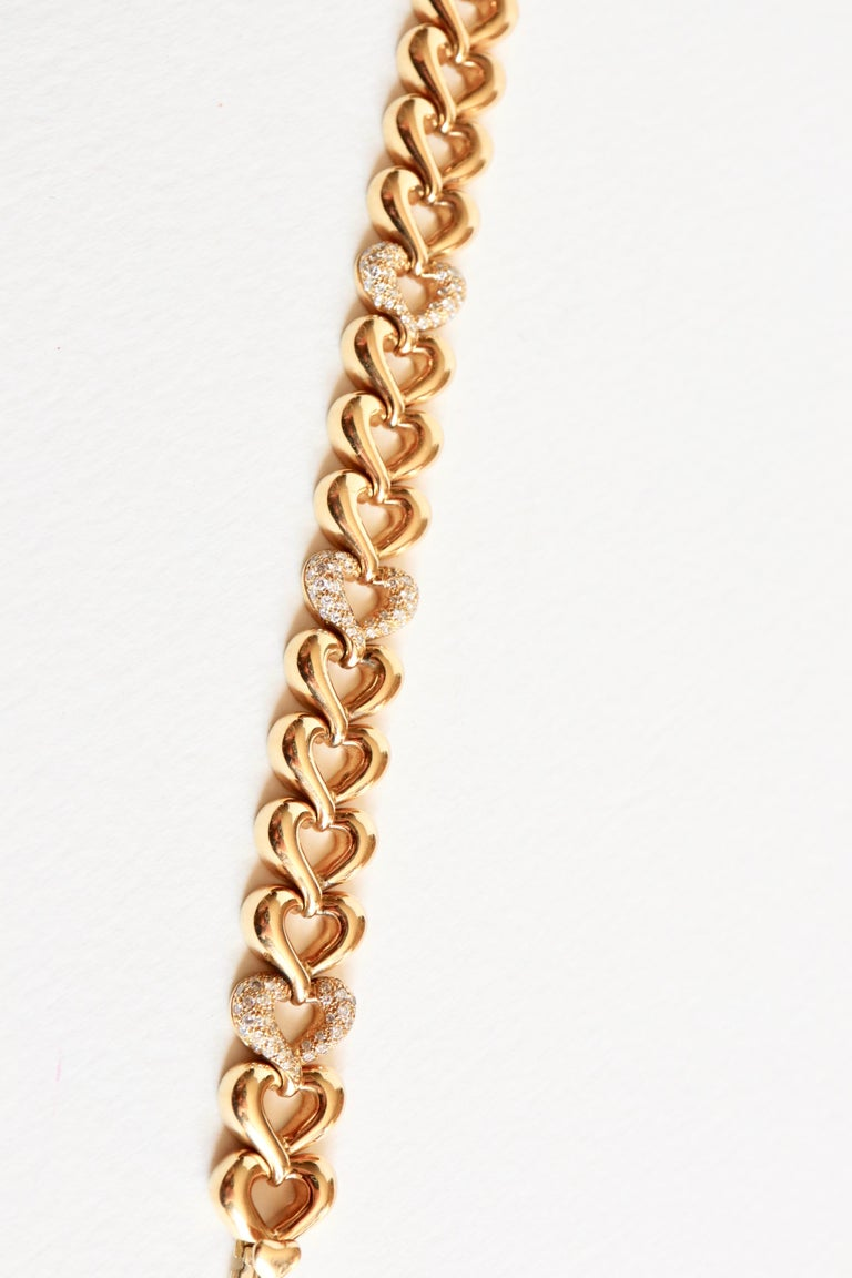 Women's Van Cleef & Arpels Articulated Heart Bracelet in 18 Carat Gold and Diamonds For Sale