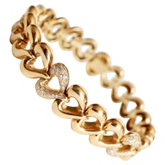 Van Cleef & Arpels Articulated Heart Bracelet in 18 Carat Gold and Diamonds