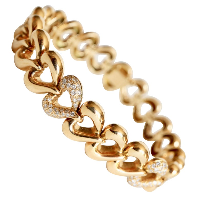 Van Cleef & Arpels Articulated Heart Bracelet in 18 Carat Gold and Diamonds For Sale
