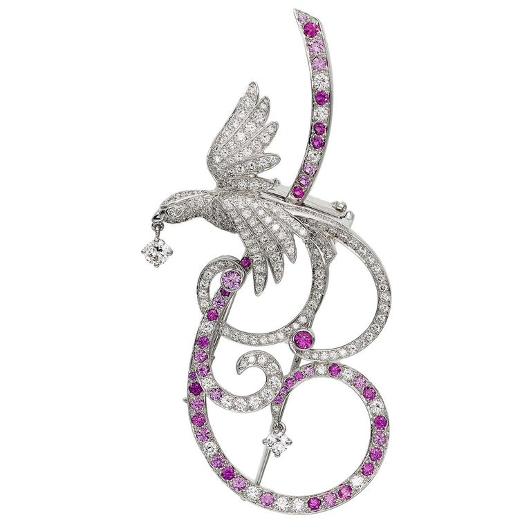 An incredible Van Cleef & Arpels Bird of paradise, set with brilliant-cut diamonds and pink sapphires mounted in 18 karat white gold. The brooch can be worn as a pendant as well and the pink sapphires range from low to strong saturation creating an
