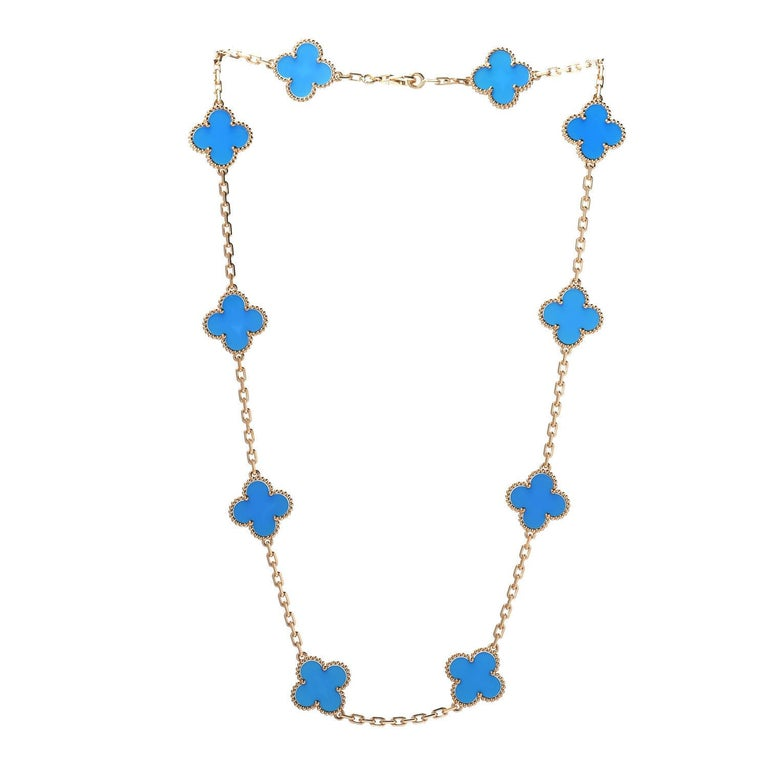 Amazing timeless design by Van Cleef & Arpels. This amazing necklace is from the Alhambra collection. Inspired by the clover leaf, these icons of luck are adorned with a border of gold. This necklace design is set with Blue Agate gemstones. The blue