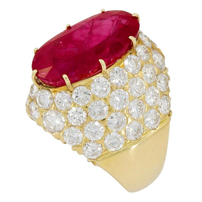 VAN CLEEF & ARPELS Burma No-Heat Ruby Diamond Ring 18k yellow gold set with oval-shaped Burma no heat ruby and diamond ring, signed Van Cleef & Arpels, 1970's. Ruby – 12.80 cts. with AGL certificate