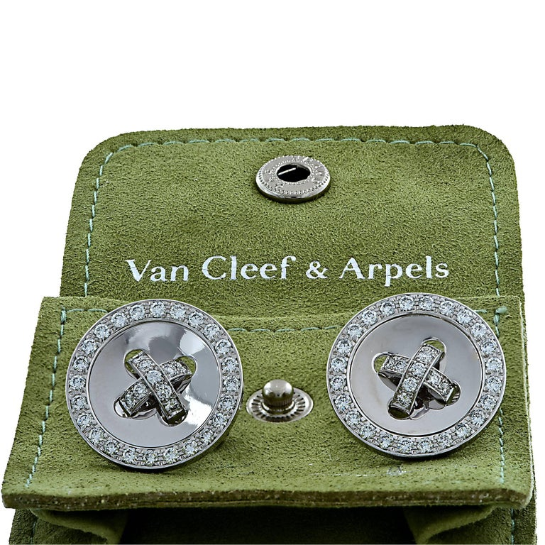 18k white gold Van Cleef & Arpels button earrings featuring 66 round brilliant cut diamonds weighing approximately 1.9cts total F color VS clarity.  Measure 20.5mm in diameter  It is stamped and/or tested as 18k gold. The metal weight is 16.40