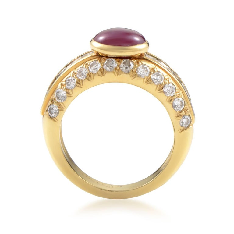 This classic design from Van Cleef & Arpels is absolutely divine. The ring is made of 18K yellow gold, and boasts a gorgeous ruby cabochon main stone, weighing in total 2ct. Lastly, the shanks are set with 1.25ct of diamonds. Ring Size: 5.5 (50