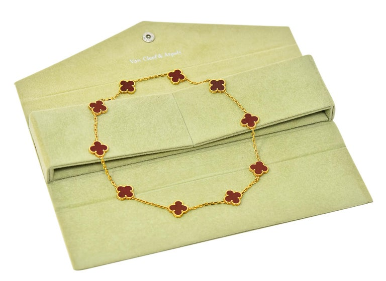 Featuring ten classic carnelian Alhambra stations with beaded gold surrounds  Fully stamped VCA for Van Cleef & Arpels with serial number  Completed by lobster claw closure  Stamped AU750 for 18 karat gold  Length: 17 Inches  Each station measures