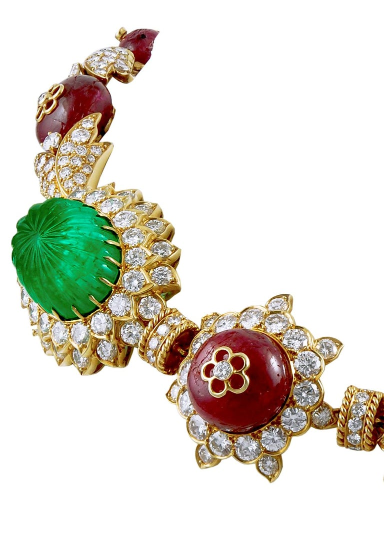 VAN CLEEF & ARPELS Carved Emerald, Ruby, Diamond Necklace-Bracelet Combination  Of Indian inspiration, set at the front with three carved emerald cabochons and four larger ruby beads, the backset with four carved emerald beads alternating with seven