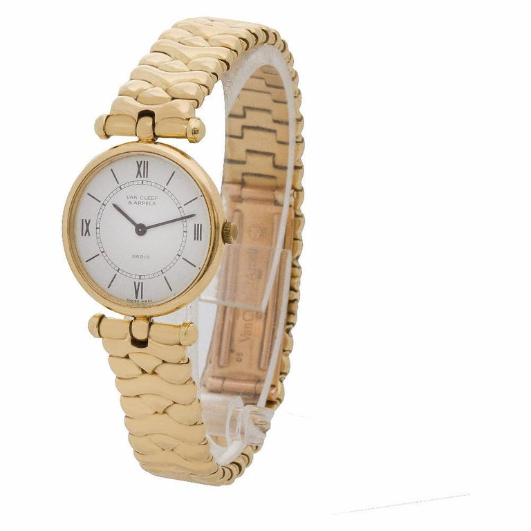 Timeless Ladies Van Cleef & Arpels Classic in 18k yellow gold. Quartz. 24 mm case size. Ref 18601cc1. Circa 1990s. Fine Pre-owned Van Cleef & Arpels Watch. Certified preowned Vintage Van Cleef & Arpels Classic 18601cc1 watch is made out of yellow