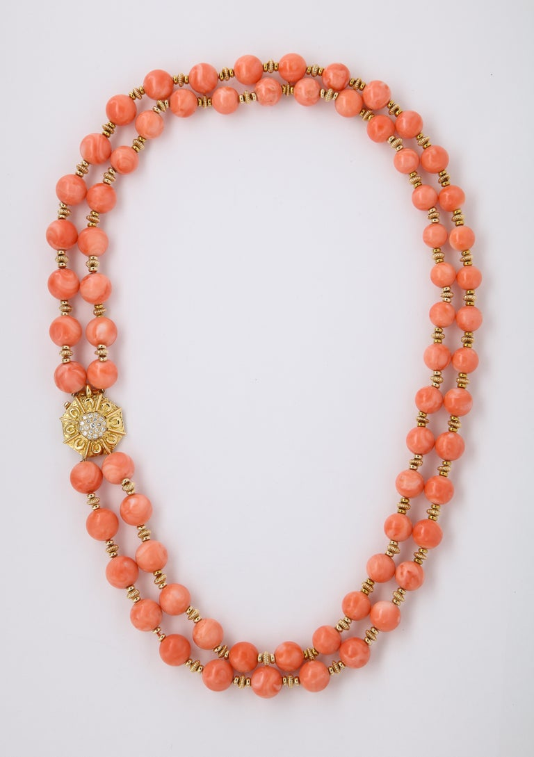 Van Cleef & Arpels Coral Bead Necklace, double strands of beads with 18K Yellow Gold spacers  & diamonds set at the clasp 68  beads  approx 8.80 mm to 11.50 mm 19 round cut diamonds Diamond Weight: approx 0.40 - 0.50 Cts  Signed VCA , Marked made in