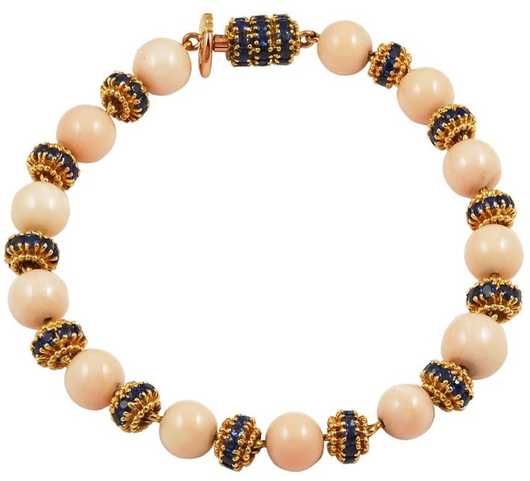 VAN CLEEF & ARPELS Coral Sapphire Convertible Necklace in 18k Yellow Gold. Exceptionally crafted by Van Cleef & Arpels, this angel skin coral necklace is convertible and can be worn multiple ways: as a long Matinee necklace, a shorter