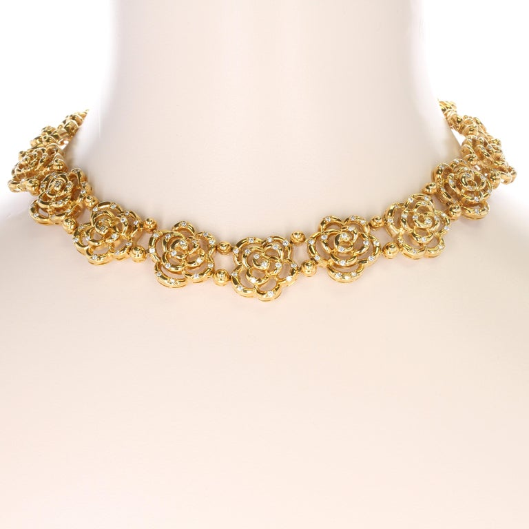 An elegant and chic Van Cleef & Arpels 18kt high-polish yellow gold openwork blossom necklace with camellia motifs sprinkled with 165 round brilliant-cut diamonds weighing approximately three to four carats of E/F color and VVS/VS clarity. The