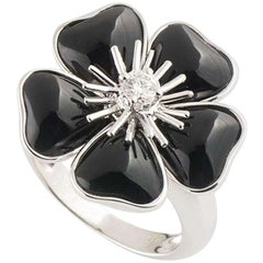Van Cleef & Arpels Diamond and Onyx Nerval Flower Ring