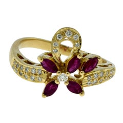 Van Cleef & Arpels Diamond and Ruby Flower Ribbon Yellow Gold Vintage Ring