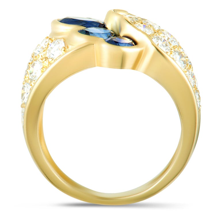 Fabulously designed in shimmering 18K yellow gold, this spectacular ring is an extravagant design by Van Cleef & Arpels. The exquisite ring is fabulously embellished with 2.40ct of sparkling diamonds and 2.50ct of captivating sapphires. Ring Top