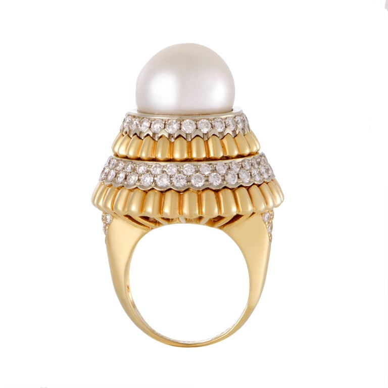 Extravagant offbeat design makes this statement piece from Van Cleef & Arpels a captivating sight to behold. It is made of a luxurious combination of 18K yellow and white gold and decorated with a gorgeous pearl and 2.95 carats of resplendent