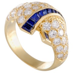 Van Cleef & Arpels Diamond and Tapered Baguette Sapphire Yellow Gold Ring