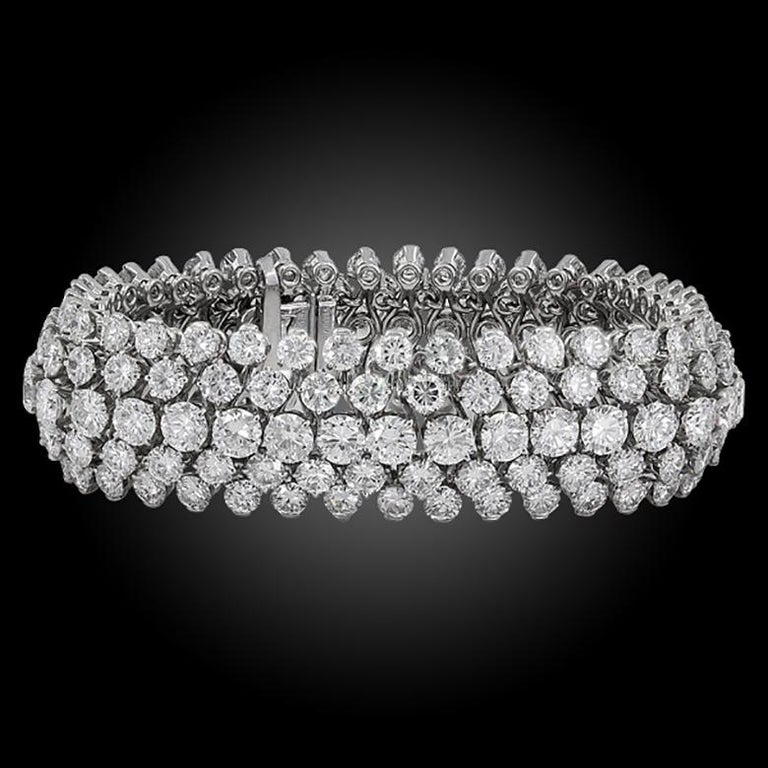 VAN CLEEF & ARPELS Diamond Bombe Bracelet in Platinum. Five-rows of tiered diamonds gives this Van Cleef & Arpels bracelet a gorgeous bombè shape when worn. Diamond weight approx. 50.00 carats total. Measures approx. 7″ in length, 0.73″ in width,