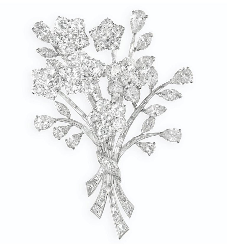 Van Cleef & Arpels Diamond Bouquet Brooch. This diamond brooch has circular, pear, marquise and baguette-cut diamonds all set in platinum and 18k white gold. Signed Van Cleef & Arpels (VCA), no. XXXXXX , and has French Hallmarks.  Length 2.6 inches.