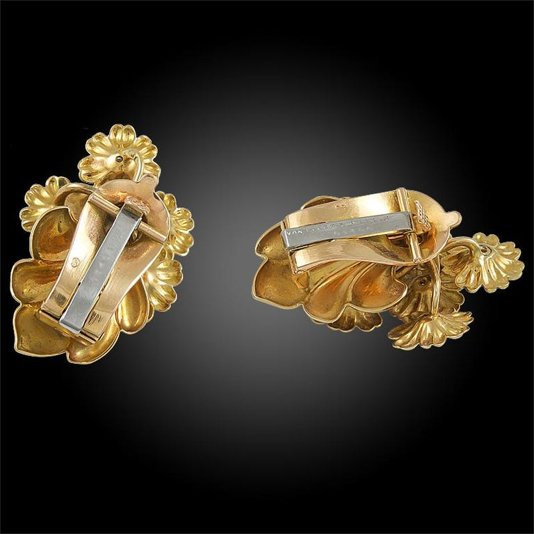 A pair of vintage Van Cleef & Arpels ear clips that date back to the 1970's, each designed as a flower bouquet made of 18k yellow gold, each flower pistil set with a brilliant round diamond.  Van Cleef & Arpels France Circa 1970'S