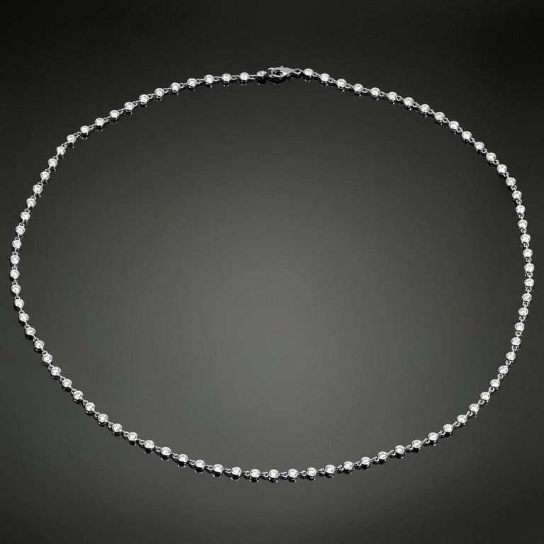 This exquisite Van Cleef & Arpels Diamond by the Yard necklace features 86 brilliant-cut round D-F VVS1-VVS2 diamonds of an estimated 5.20 carats bezel-set in 18k white gold. Made in France circa 1990s. Measurements: 0.11
