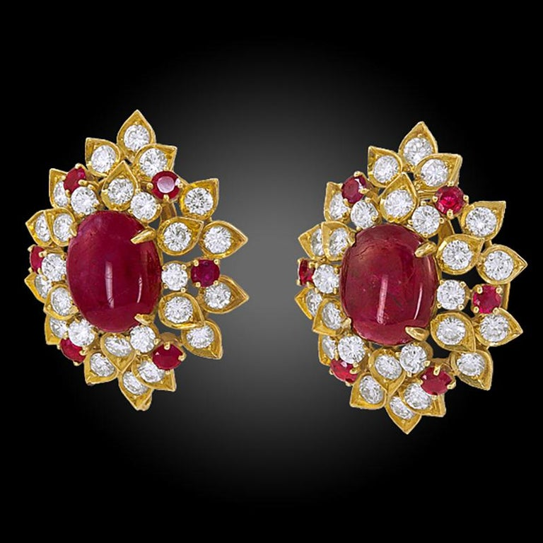 A pair of 18k yellow gold earrings, set with brilliant-cut diamonds and cabochon ruby, signed Van Cleef & Arpels.  Circa 1960s Dimensions approx. 1 1/4″ x 1″