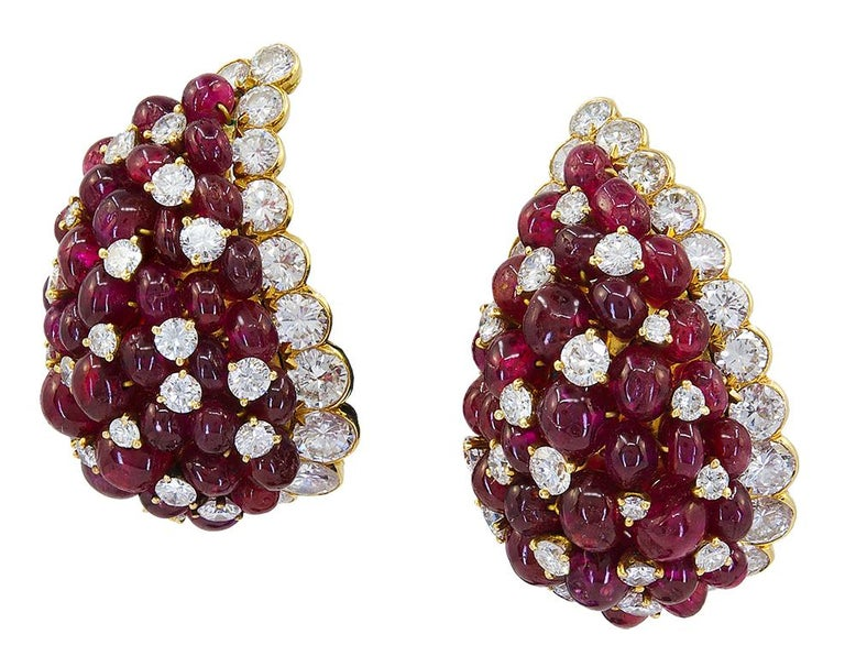 VAN CLEEF & ARPELS Diamond, Cabochon Ruby Earrings. A pair of 18k yellow gold ear clips, set with brilliant-cut diamonds and 34 cabochon rubies. Total diamond weight approx. 8.5-9.5 cts. DEF color and VS clarity. Dimensions approx. 1.28″ x