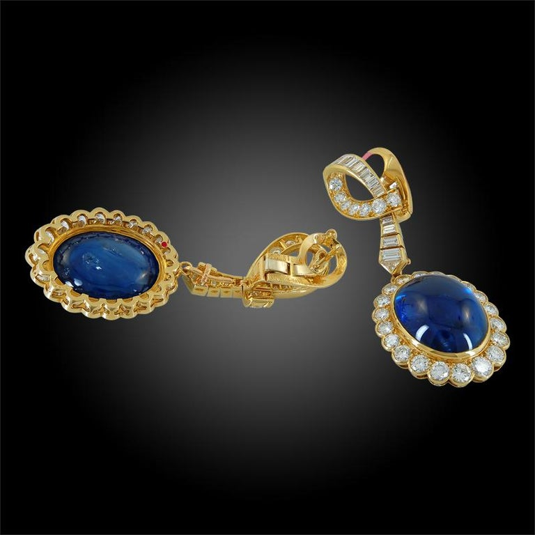 Each surmount of scroll design, set with brilliant-cut and graduated baguette diamonds, suspending a Ceylon cabochon sapphire, framed by brilliant-cut diamonds, signed Van Cleef & Arpels, numbered, French assay marks for gold and maker's marks,