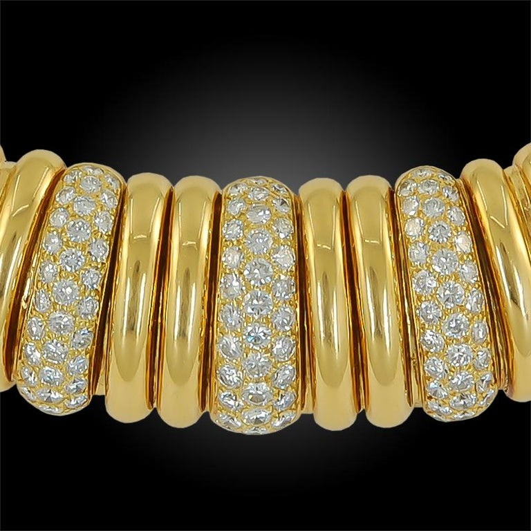 A stylish vintage Van Cleef & Arpels choker necklace that dates back to the 1940s, comprised of 18k yellow gold with brilliant diamond accents.  Signed Van Cleef & Arpels.