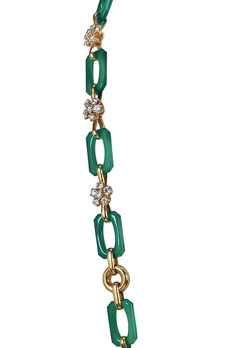 A remarkable Van Cleef & Arpels long 18k gold link necklace that dates back to the 1970's, elegantly set with alternating interlocking links made of 18k gold and chrysoprase. Every other gold link is adorned with round cut diamonds formed to create
