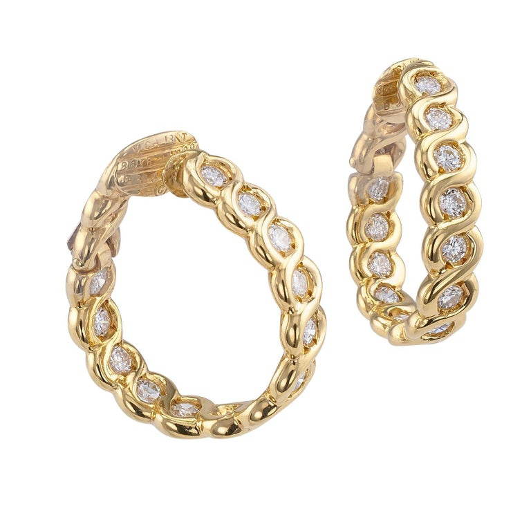 Van Cleef & Arpels diamond clip-on hoop earrings circa 1990.  DETAILS: DIAMONDS: twenty-six round brilliant-cut diamonds totaling approximately 1.82 carats, approximately F – G color and VVS clarity. METAL: 18-karat yellow gold. SIGNED: VCA, maker's