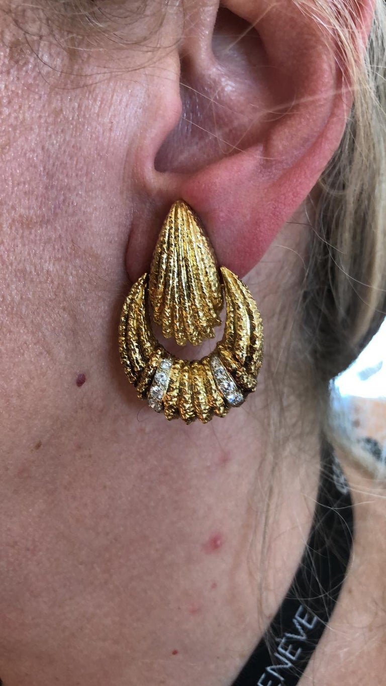 Intricately crafted Van Cleef & Arpels earrings, comprised of textured 18k yellow gold with brilliant diamond accents, Signed Van Cleef & Arpels, vintage and estate collection. Dimensions approx. 1.5″ in length by  1″ in width Condition: Good -