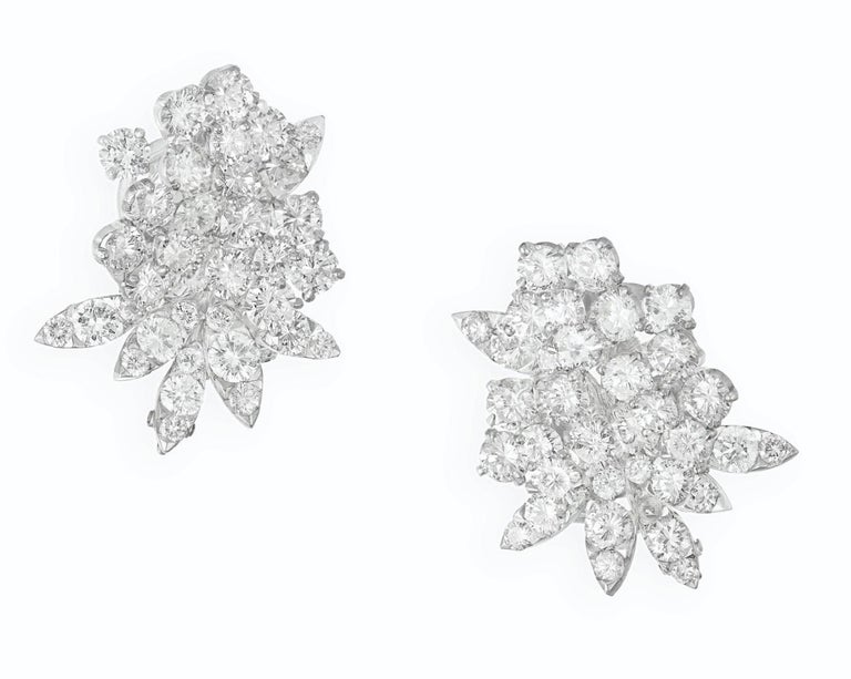 Van Cleef & Arpels Diamond Flower Earrings.  This pair of earrings has circular- cut diamonds weight approximately 9-10ct all set in 18k white gold.  Signed:  Van Cleef & Arpels & numbered xxxxxx Maker's mark and French Hallmark  Measurements: 1.00