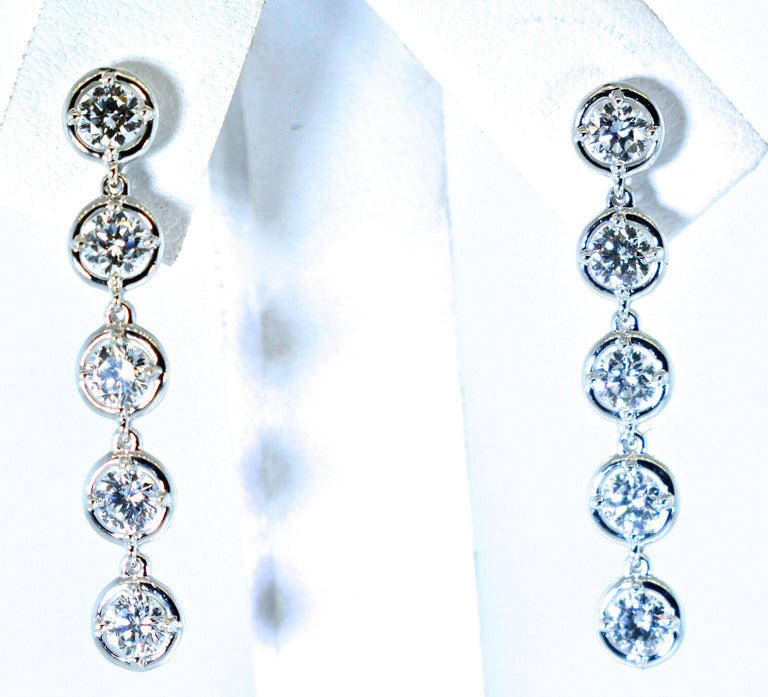 Van Cleef & Arpels diamond drop earrings with 10 diamonds all well cut and well matched, approximately colorless (F), and very very slightly included (VVS) quality.  The total diamond is estimated to be 2.2 cts.  These 1.25 inch long well made