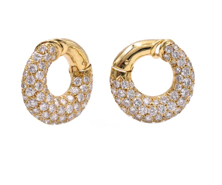 Pair of Gold and Diamond Hoop Earclips, Van Cleef & Arpels, France. The bombé hoops pavé- set with 116 round diamonds approximately 7.00 cts, color F-G, clarity VS.  Signed VCA, 79, no. xxxxxx CS,  with maker's marks and French assay marks.