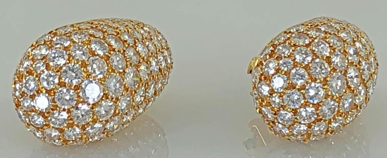 18k yellow gold diamond bombe oval design earrings signed Van Cleef & Arpels.