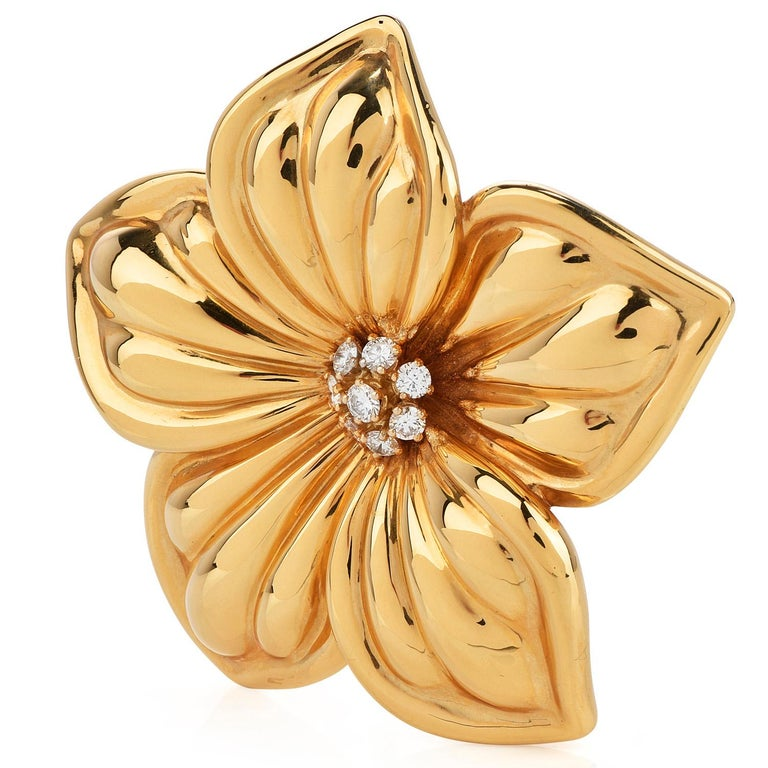Bright and dazzling diamond & 18K yellow gold brooch,inspired by the natural elegance of the Magnolia Flower.  Crafted in solid 18K yellow gold, composed of (7) round-cut, prong-set, Diamonds weighing approximately 0.75carats (E-Fcolor and