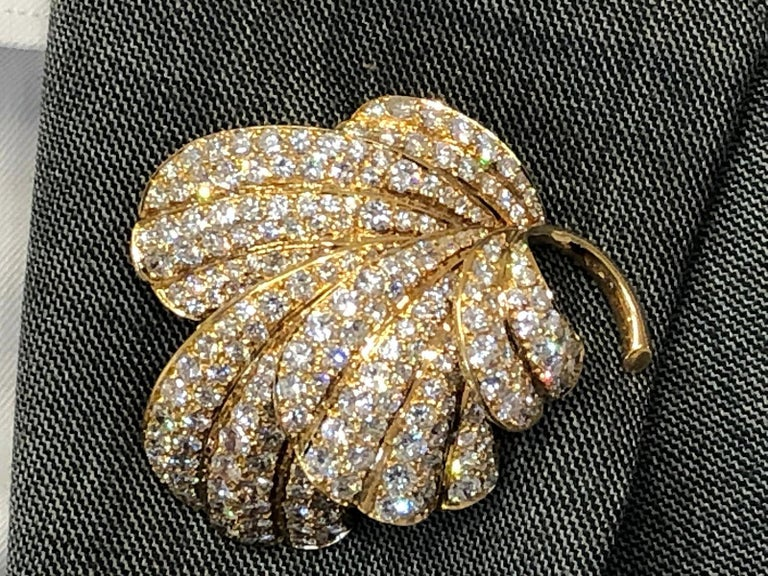 An exceptional vintage brooch by Van Cleef & Arpels, comprised as a foliate motif of a leaf, crafted with 18k yellow gold, encrusted with brilliant round cut diamonds weighing approximately 20 carats, signed Van Cleef & Arpels. dimensions approx.