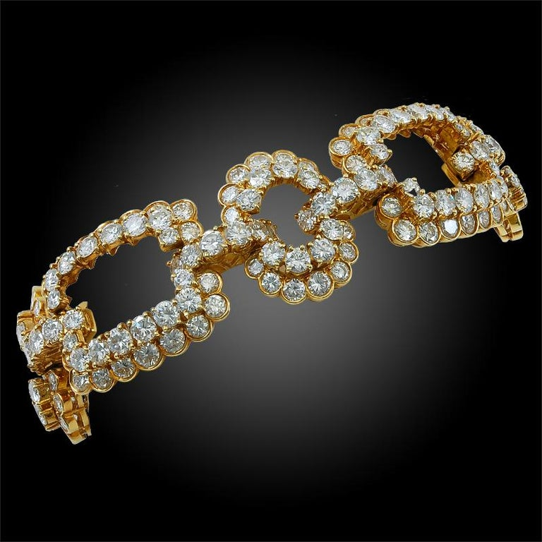 An exceptional large link bracelet by Van Clef & Arpels that dates back to the 1980's, crafted in 18k yellow gold, embellished with approximately 47 carats of brilliant VVS diamonds. The bracelet measures approximately 7 3/4″ in length and 3/4″ in