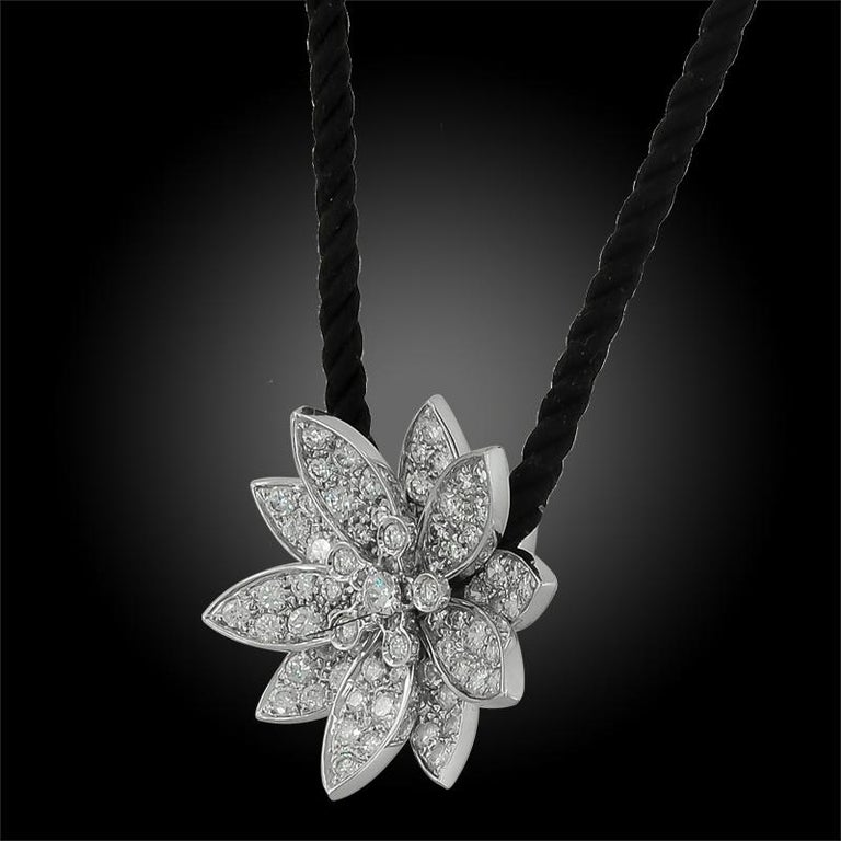 18k white gold pendant with black cord Lotus necklace, set with round brilliant-cut diamonds.  Numbered and signed Van Cleef & Arpels.