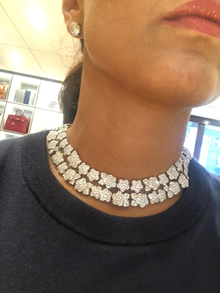 An exceptional Melusine Necklace by Van Cleef & Arpels circa the 1990s, comprising a double row of floral designs crafted in platinum, thoroughly embellished with brilliant diamonds weighing approximately 36 carats in its entirety.  Numbered and