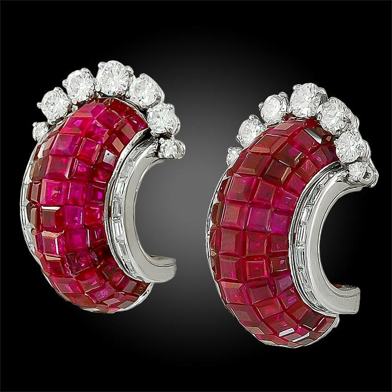 VAN CLEEF & ARPELS Mystery Set™ Ruby Diamond Half Hoop Earrings in Platinum.  An important pair of half-hoops featuring calibré-cut rubies in the famous Mystery Set™ technique by Van Cleef & Arpels. Emblematic to the gem setting, a mosaic of color