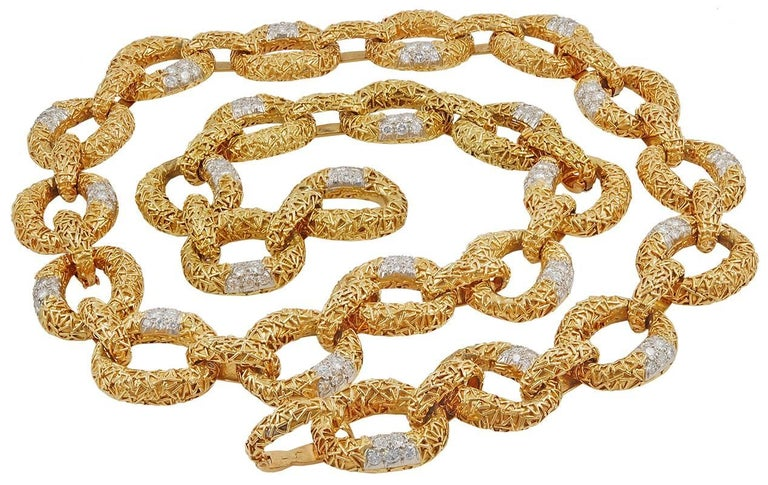 An exquisite pendant composed of textured gold, accented by luminous round diamonds, suspended from a similarly-set necklace, total gross weight approximately 202 dwt., length 28½ inches, with four removable segments for a variety of wear each