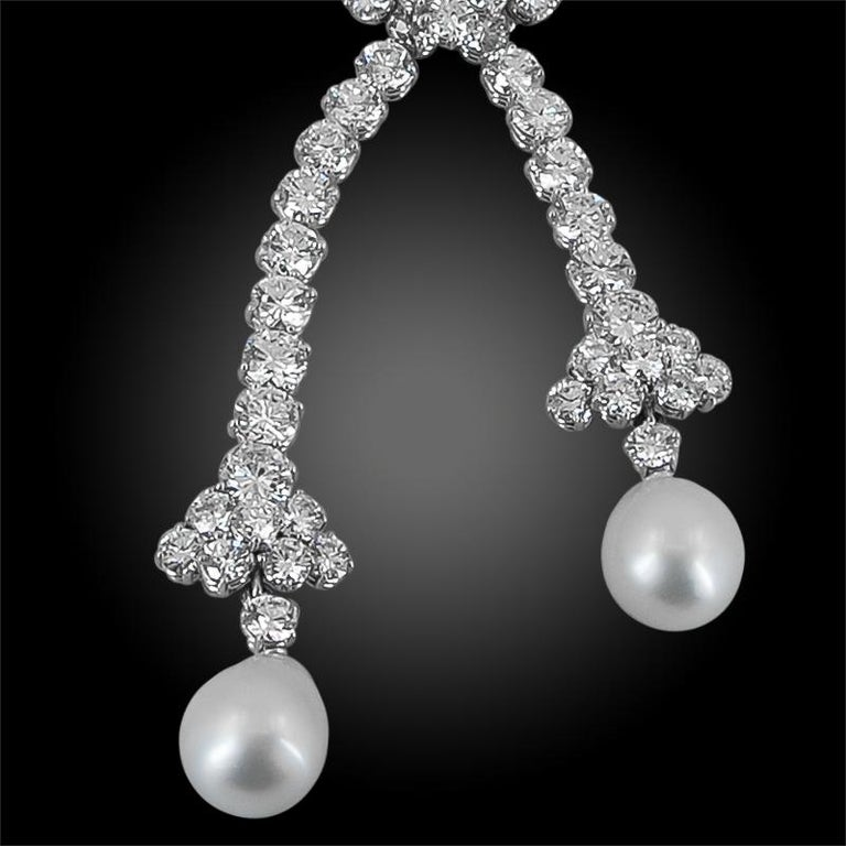 Exceptionally crafted by Van Cleef & Arpels in 1985, comprising a long detachable necklace set with brilliant diamonds mounted in 18k white gold, centering two hanging pearls. This exquisite piece is accompanied by VCA Certificates. Measures 14.5 X