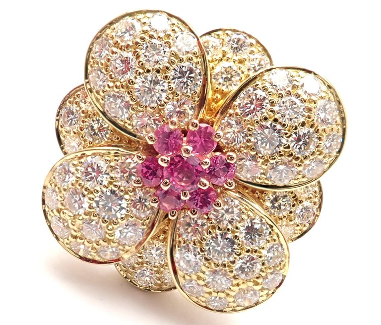 18k Rose Gold Diamond And Pink Sapphire Flower Ring by Van Cleef & Arpels. With brilliant cut diamonds VVS1 clarity, E color and 7 round pink sapphires. This ring comes with Van Cleef & Arpels box and Van Cleef & Arpels service paper. Details: Size:
