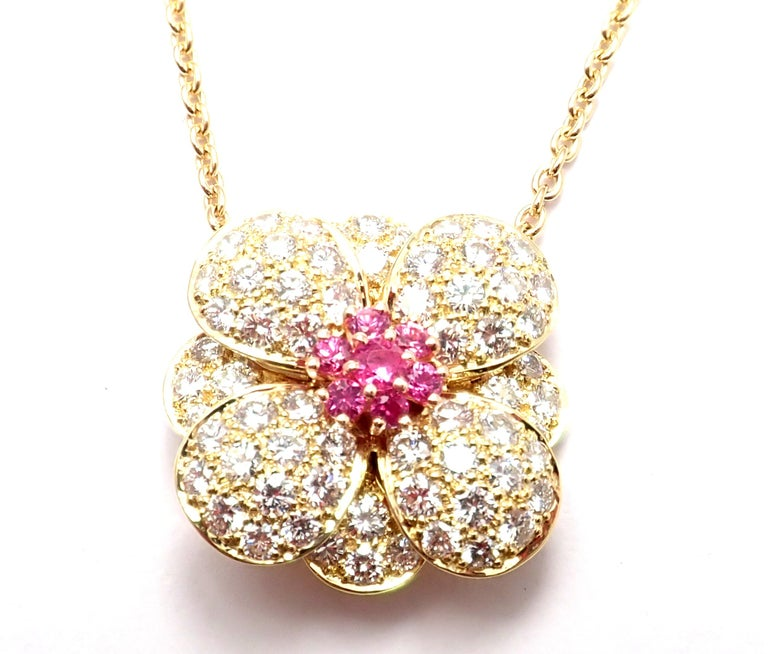 18k Yellow Gold Diamond And Pink Sapphire Flower Pendant Necklace by Van Cleef & Arpels. With brilliant cut diamonds VVS1 clarity, E color and 7 round pink sapphires. This necklace comes with Van Cleef & Arpels service paper. Details: Length: