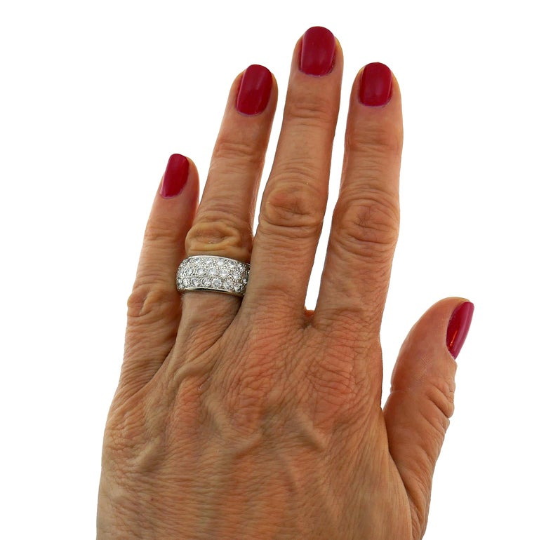 Timeless and elegant band ring created by Van Cleef & Arpels in France. Classic design, perfect proportions.  The ring is made of platinum and set with sixty three round brilliant cut diamonds F-G color, VS1 clarity, total weight approximately 5.46